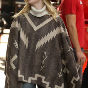 a rainy day in new york elle fanning turtleneck poncho sweater