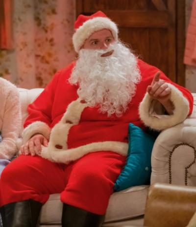 the goes wrong show robert santa claus christmas coat
