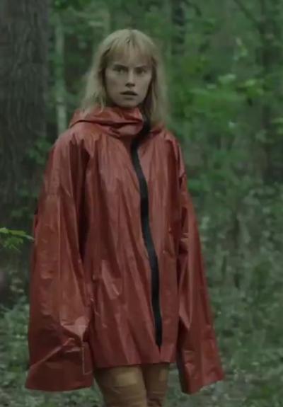 Viola Eade Chaos Walking Daisy Ridley Orange Rain Coat
