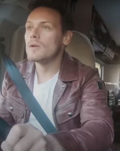 men in kilts a roadtrip with sam and graham sam heughan purple jacket