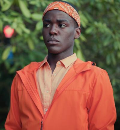 Sex Education S03 Eric Effiong Orange Jacket